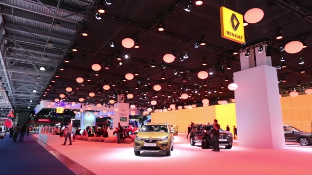 Models stand by automobiles at the Renault SA stand at the Moscow International Auto Salon in Moscow Russia on Wednesday Aug 27 Wide general views...