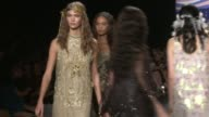 Models walk the runway at Anna Sui Spring 2014 MercedesBenz Fashion Week in New York NY on 9/11/13