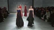 Models walk the runway at Lie Sang Bong Fall 2014 MercedesBenz Fashion Week at The Pavilion at Lincoln Center on in New York City