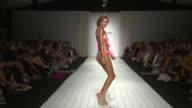 Models walk the runway at Luli Fama 2016 Collection Runway FUNKSHION Swim Week Miami Beach at FUNKSHION Tent on July 18 2015 in Miami Florida