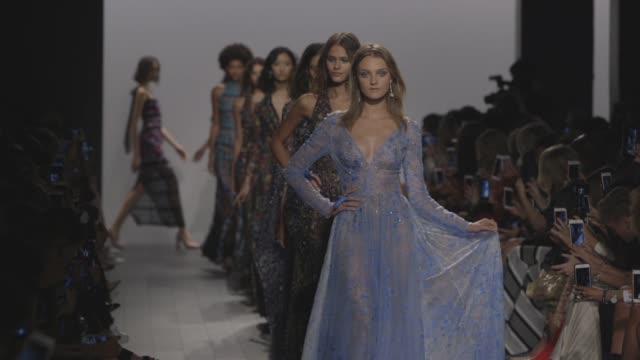 Models walk the runway at Tadashi Shoji Runway September 2017 New York Fashion Week The Shows at Skylight Clarkson Sq on September 07 2017 in New...