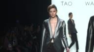 Models walk the runway at Taoray Wang Runway Fall 2016 New York Fashion Week The Shows at The Dock Skylight at Moynihan Station on February 13 2016...