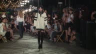 Models walk the runway at Tommy Hilfiger September 2016 New York Fashion Week at Pier 16 South Street Seaport on September 09 2016 in New York City