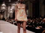 Models wear floral pantaloon minidresses designed by Scarabocohio at a fashion show in Florence