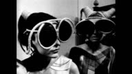 Models wearing giant sunglasses / models walk runway wearing Pucci Lancetti and Gregoriana fashions such as shift dresses velvet gowns matching...
