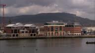 Modern apartment buildings sit alongside Belfast's docks. Available in HD.