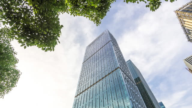 modern blue building with glass wall  in cloud sky.timelapse hyperlapse