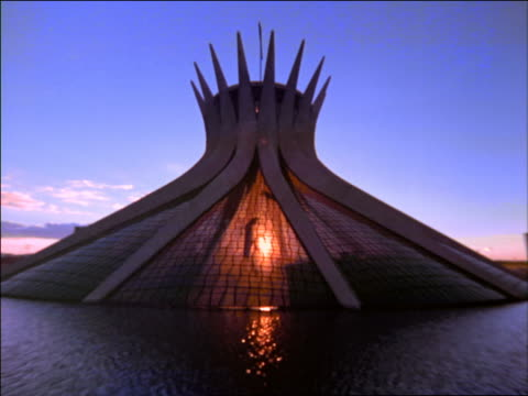Modern building with spiky top surrounded by moat / Brasilia, Brazil