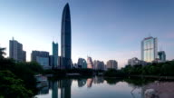 modern buildings exterior and pond in shenzhen,night to day.Time lapse.