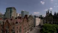 Modern buildings surround the Victorian Manchester Town Hall in England. Available in HD.