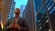Modern businessman dressing up in downtown Chicago