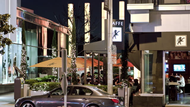 MS T/L Modern cafe with indoor and outdoor seating areas next to clothing retail store on Sunset Strip / West Hollywood, California, USA