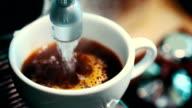 Modern coffee maker makes a cup of strong black coffee