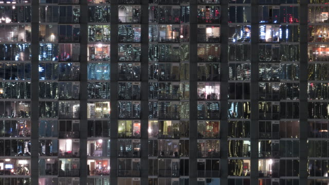 Modern condo building night time lapse