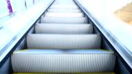 Modern escalator in motion moving upward