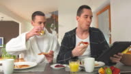 HD DOLLY: Modern Gay Couple Eating Breakfast