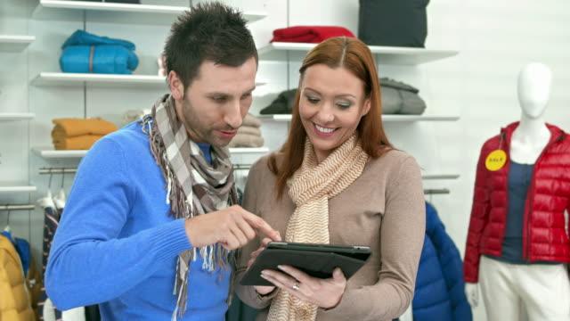 HD DOLLY: Modern Saleswoman Assisting Customer