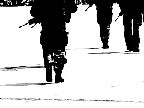 Modern soldiers with weapons in surveillance mission