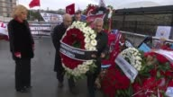 Moldovian Deputy Prime Minister and Economy Minister Octovian Calmic and Governor of Autonomous Territorial Unit of Gagauzia Irina Vlah place wreaths...