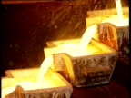 Molten gold pours into moulds Ghana 09 Nov 98