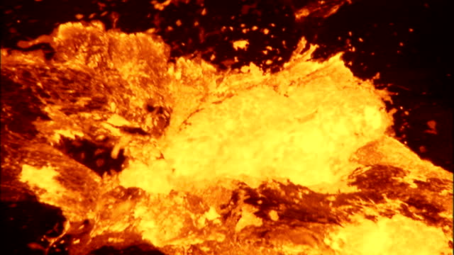 Molten lava bubbles and spurts as a volcano erupts. Available in HD.