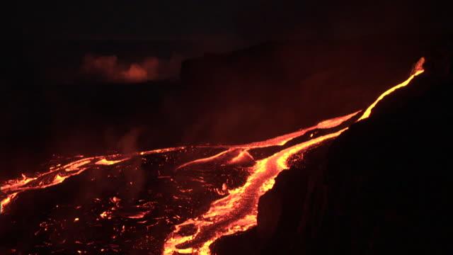 Molten lava flows from erupting volcano, Big Island, Hawaii