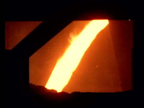Molten steel pours from furnace in steel mill, Poland