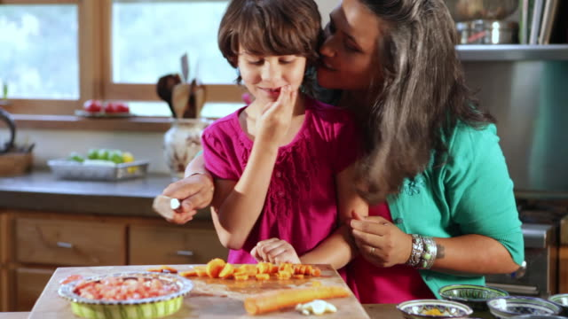 CU Mom and daughter cooking in kitchen / Santa Fe, New Mexico, United States