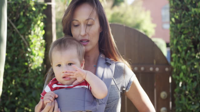 Mom holding baby in baby carrier