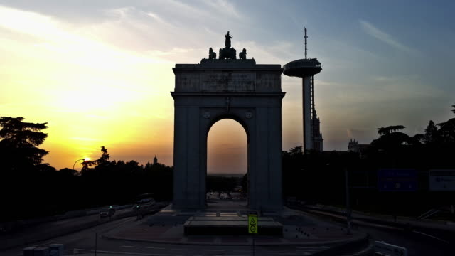 moncloa arc gate door and lighthouse in madrid with sunset hyperlapse