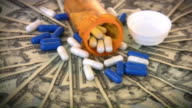 Money and medicine. Medical expenses. Dollars, cash, drugs, pills.