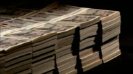 Money bands hold together bundles of ten thousand yen bills in Tokyo, Japan.