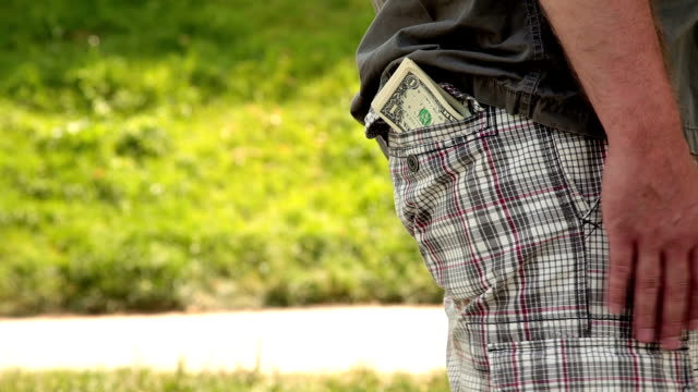 HD - Money Falls out of Pocket