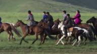 Mongolia : Horses and rider galloping