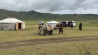 Mongolians with a few yaks at a yurt camp at Orkhon Valley in Mongolia