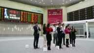 Monitors display the Korea Composite Stock Price Index figure top and the exchange rate between the South Korean won and the US dollar at the Korea...