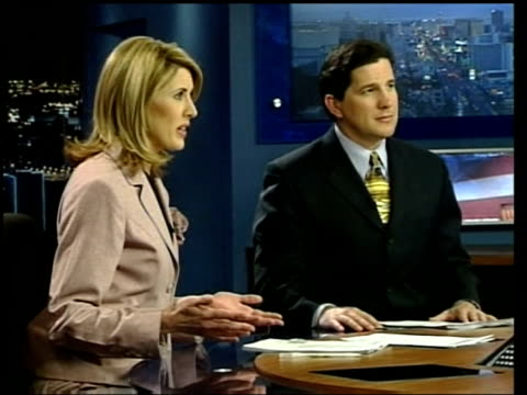 Monitors in 'News 3' television news studio Hand pushing button on control desk Newsreader speaking as preesenting news programme SOT Screen PAN...