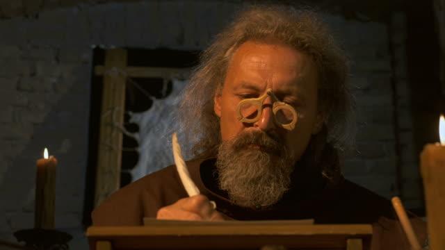 HD: Monk Carefully Scribing Testaments