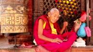 Monk praying prayer beads