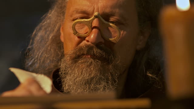 HD DOLLY: Monk Scribing Text With A Quill Pen