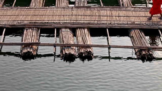 Monk walk on floating bridge