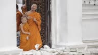 Monks at Wat Mahathat close to Bangkok's Grand Palace watch the rising flood waters as high tide approaches on October 29 2011 in Bangkok Thailand