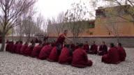 Monks debate in Samye Monastery, Qinpu, Tibet
