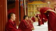Monks debating Buddhist scriptures at Jokhang temple, Lhasa, Tibet, China