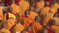 SLO MO HA MS PAN Monks praying at Mahabodhi Temple / Bodh Gaya, Bihar, India