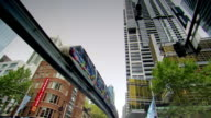 A monorail travels through the city of Sydney.