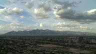 WS T/L Monsoon clouds moving over cityscape with mountains in background / Tucson, Arizona, USA