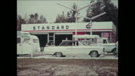 Montage: 1965 Ford truck camper at gas station