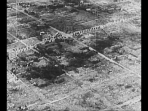 montage aerials Nagasaki destroyed after US dropped atomic bomb on the city / rubble and destruction in Hiroshima with only a few buildings remaining...