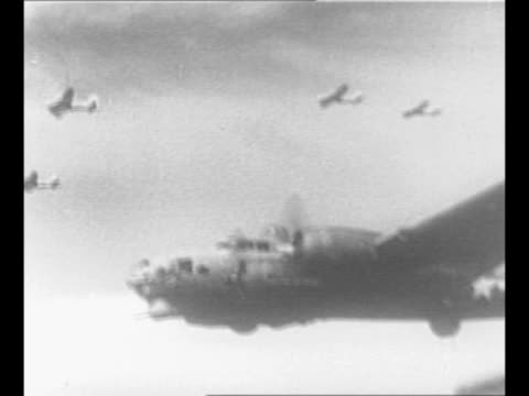 Montage Allied bombers fly including B17 Flying Fortresses / montage Luftwaffe plane flies explodes from gunfire / plane wing in foreground as bombs...